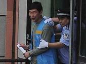 南勇被押解出法庭